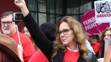 Elizabeth Perkins names James Woods on a #MeToo sign at women's march