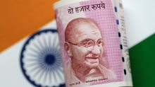 Most Asian currencies set for losing week, rupee gains