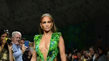 Jennifer Lopez, 50, wows in an updated version of her green Versace gown: '8th wonder of the modern world'