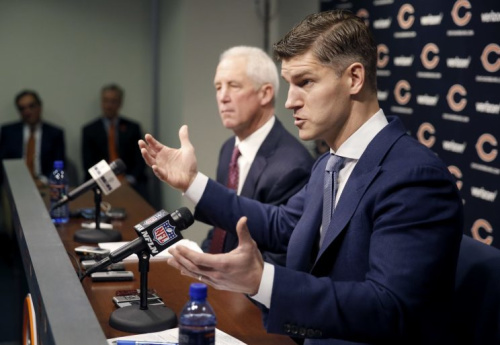 GM Ryan Pace (R) was hellbent on getting a quarterback for the future. (AP)