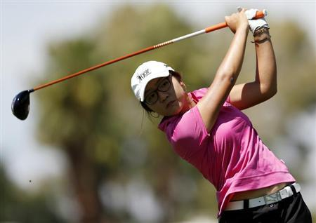 Fifteen-year old Lydia Ko of New Zealand tees off on the 12th hole during the third round of the Kraft Nabisco Championship LPGA golf tournament in Rancho Mirage