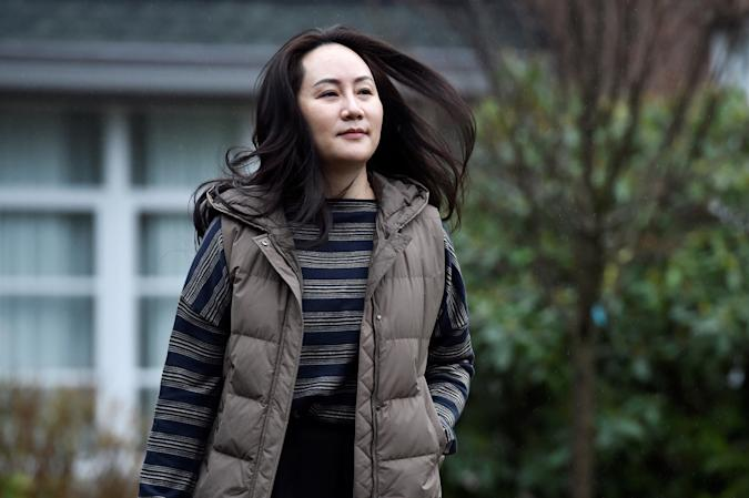 Huawei Technologies Chief Financial Officer Meng Wanzhou leaves her home to attend a court hearing in Vancouver, British Columbia, Canada December 7, 2020. REUTERS/Jennifer Gauthier     TPX IMAGES OF THE DAY