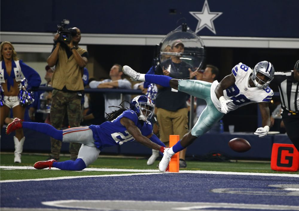 Giants cornerback Janoris Jenkins (20) breaks up a pass intended for Dallas Cowboys receiver Dez Bryant (88). (AP)