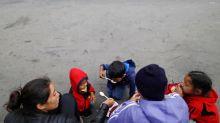 Migrants in caravan at U.S. border bide time ahead of crossing