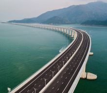 World's longest sea bridge opens in China as critics warn it will increase Beijing's grip on Hong Kong