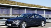 Mercedes bets on evolution as Tesla touts revolution in automated driving