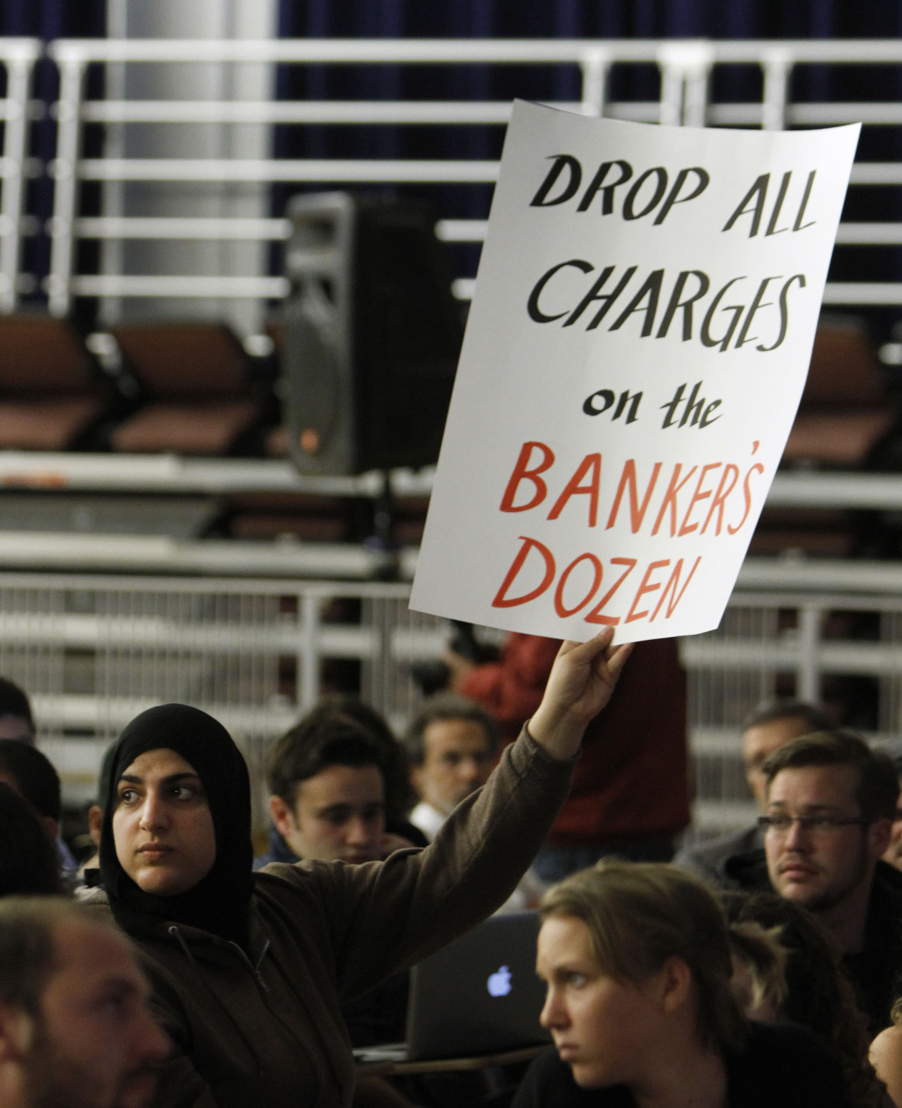 Fatima Sbeih, one of the students pepper sprayed by campus police officers at the University of California, Davis, last November, displays a sign during a town hall style meeting held at the school in Davis, Calif., Wednesday, April 11, 2012. The meeting has held to discuss the release of a report looking into the incident that prompted a national outrage. (AP Photo/Rich Pedroncelli)