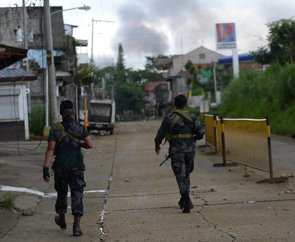 Street battles and a relentless military bombing campaign have so far failed to end the crisis in Marawi, one of the biggest Muslim cities in the mainly Catholic Philippines, and authorities have expressed alarm about the fate of those trapped (AFP Photo/TED ALJIBE)