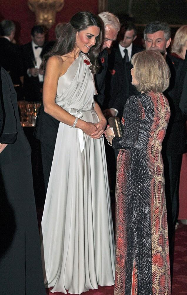 Kate spoke with dinner guests at a reception at St. James Palace, wearing a silver one-shouldered gown.