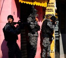 Brazil favela shootout between police and drug gang leaves 25 dead
