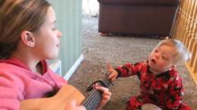 Boy with Down syndrome sings sweet duet with big sister