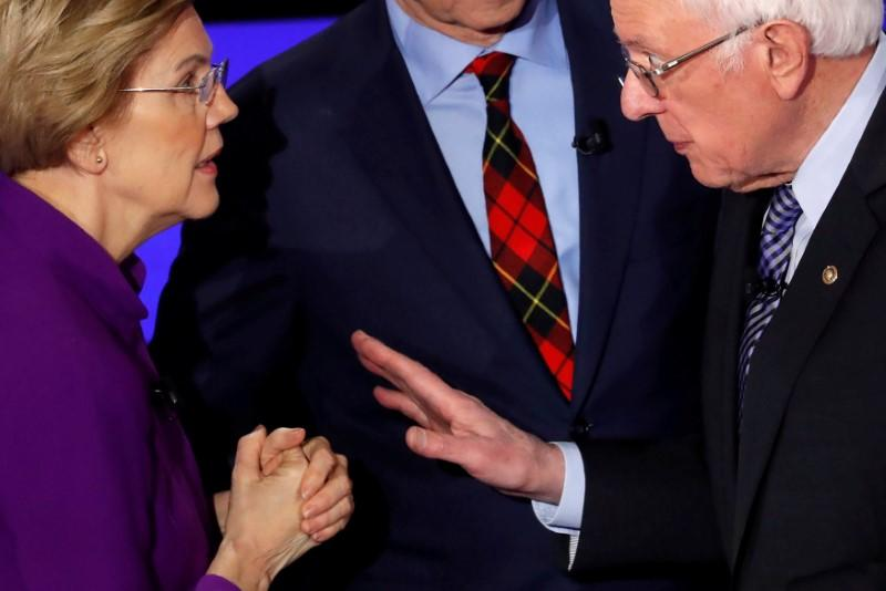 FILE PHOTO: Democratic 2020 U.S. presidential candidates Senator Elizabeth Warren speaks with Senator Bernie Sanders after the seventh Democratic 2020 presidential debate at Drake University in Des Moines