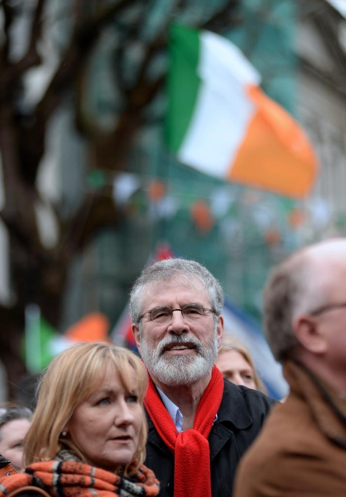 Sinn Fein leader Gerry Adams (C) listens to speeches during a march and rally organized by Right2Change and Right2Water in Dublin, Ireland, on February 20, 2016 against water charges and austerity ahead of the 2016 election (AFP Photo/Caroline Quinn)