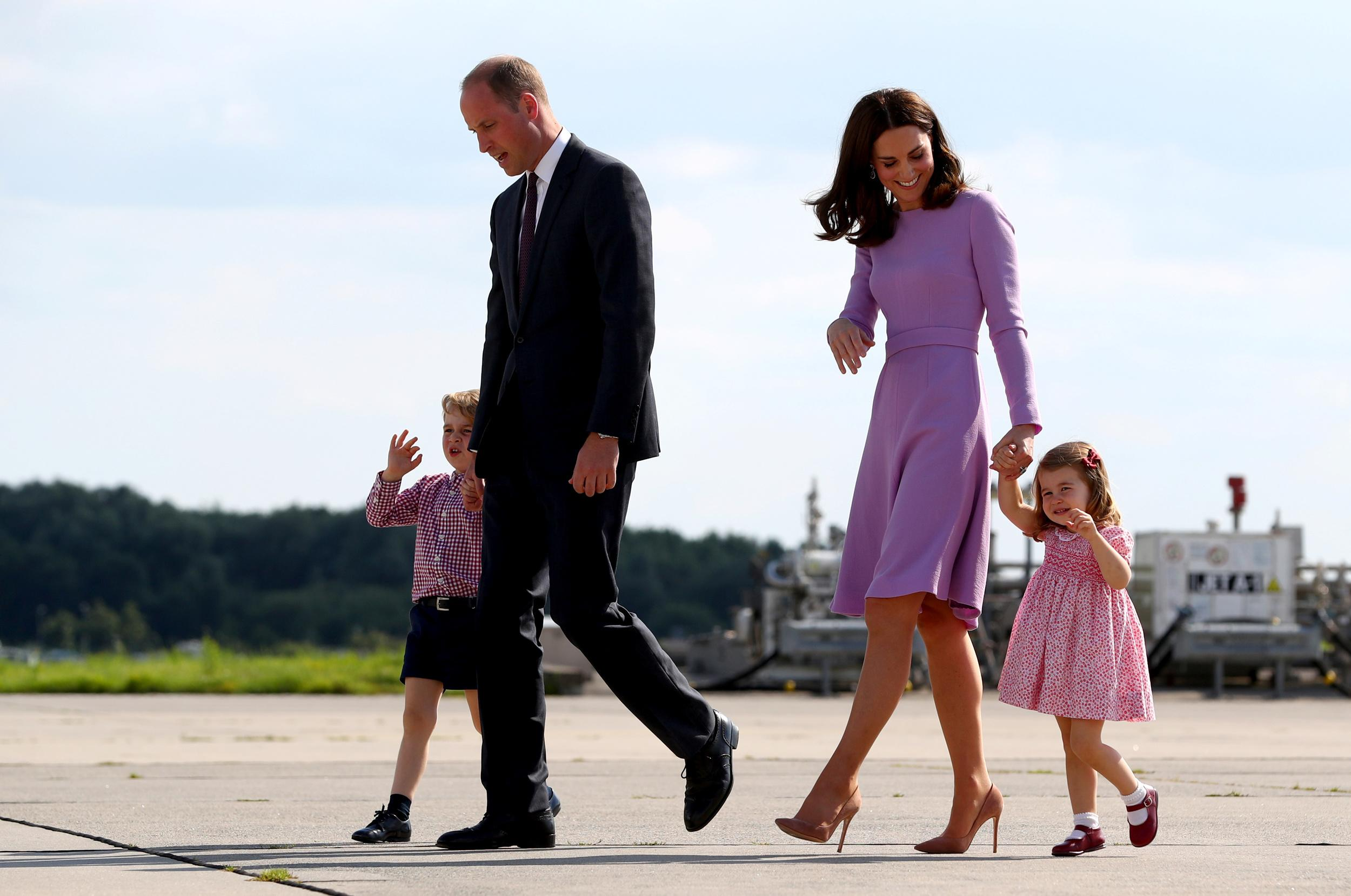 Britain's Prince William, the Duke of Cambridge, his wife Princess Kate, the Duchess of Cambridge, Prince George and Princess Charlotte walk at the airfield in Hamburg Finkenwerder, Germany, July 21, 2017.    REUTERS/Christian Charisius/POOL