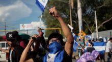 Nicaraguan students yell 'Murderer' at Ortega, demand he resign