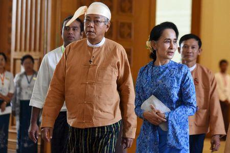 Myanmar's new president Htin Kyaw (L) and National League for Democracy party leader Aung San Suu Kyi arrives to parliament in Naypyitaw