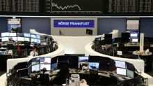 UBS, global growth worries send European shares into the red