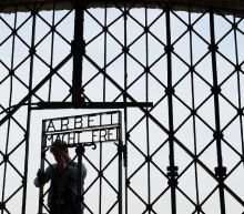 Stolen Dachau 'Work will set you free' gate found in Norway