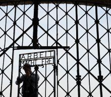 Stolen Dachau 'Work will set you free' gate found in Norway
