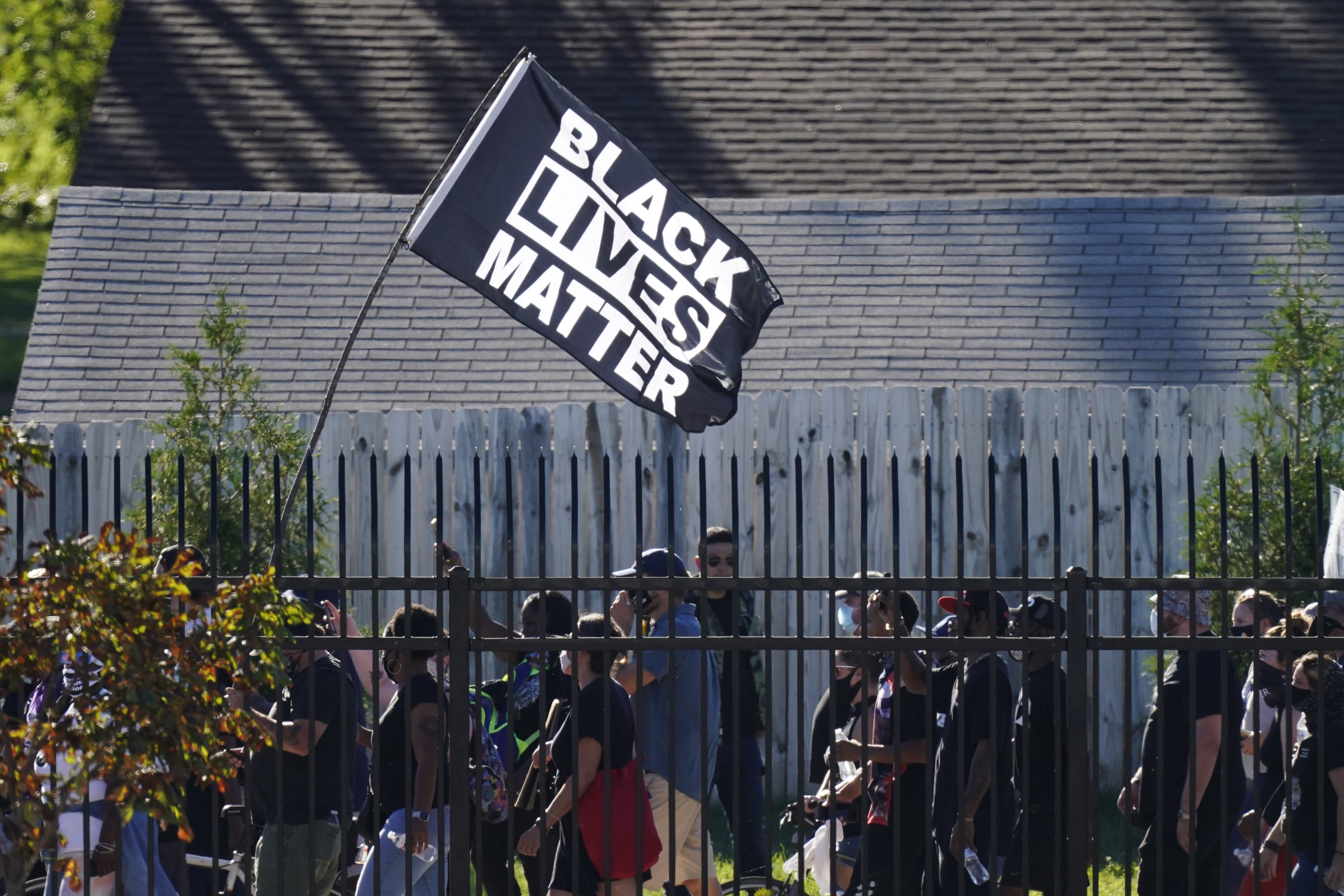 Protesters march past the Churchill Downs racetrack before the 146th running of the Kentucky Derby horse race, Saturday, Sept. 5, 2020, in Louisville, Ky. (AP Photo/Charlie Riedel)