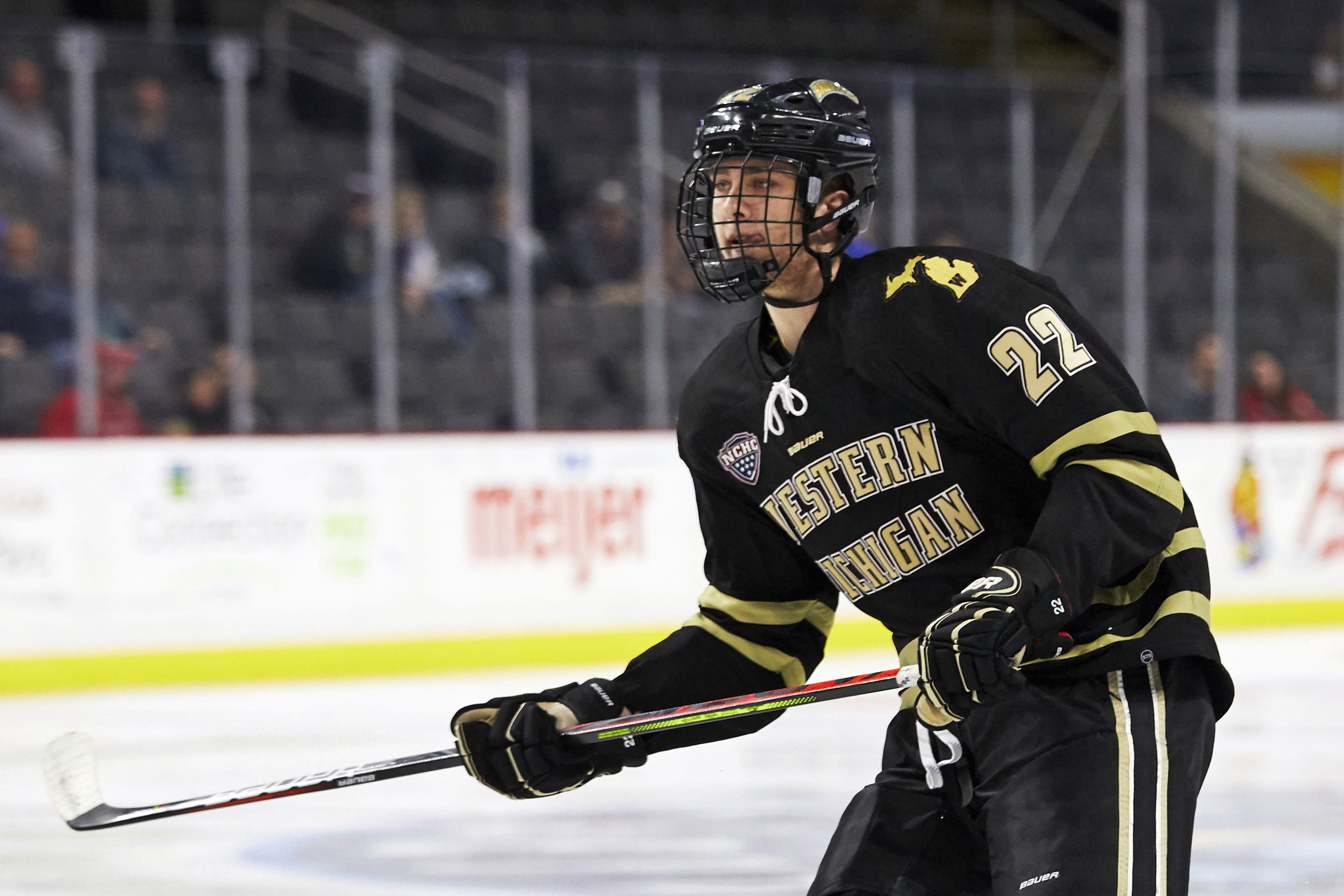 FILE - In this Oct. 11, 2019, file photo, Western Michigan forward Austin Rueschhoff (22) skates Ohio State during an NCAA college hockey game in Toledo, Ohio. Rueschhoff signed with the New York Rangers recently. (AP Photo/Rick Osentoski, File)