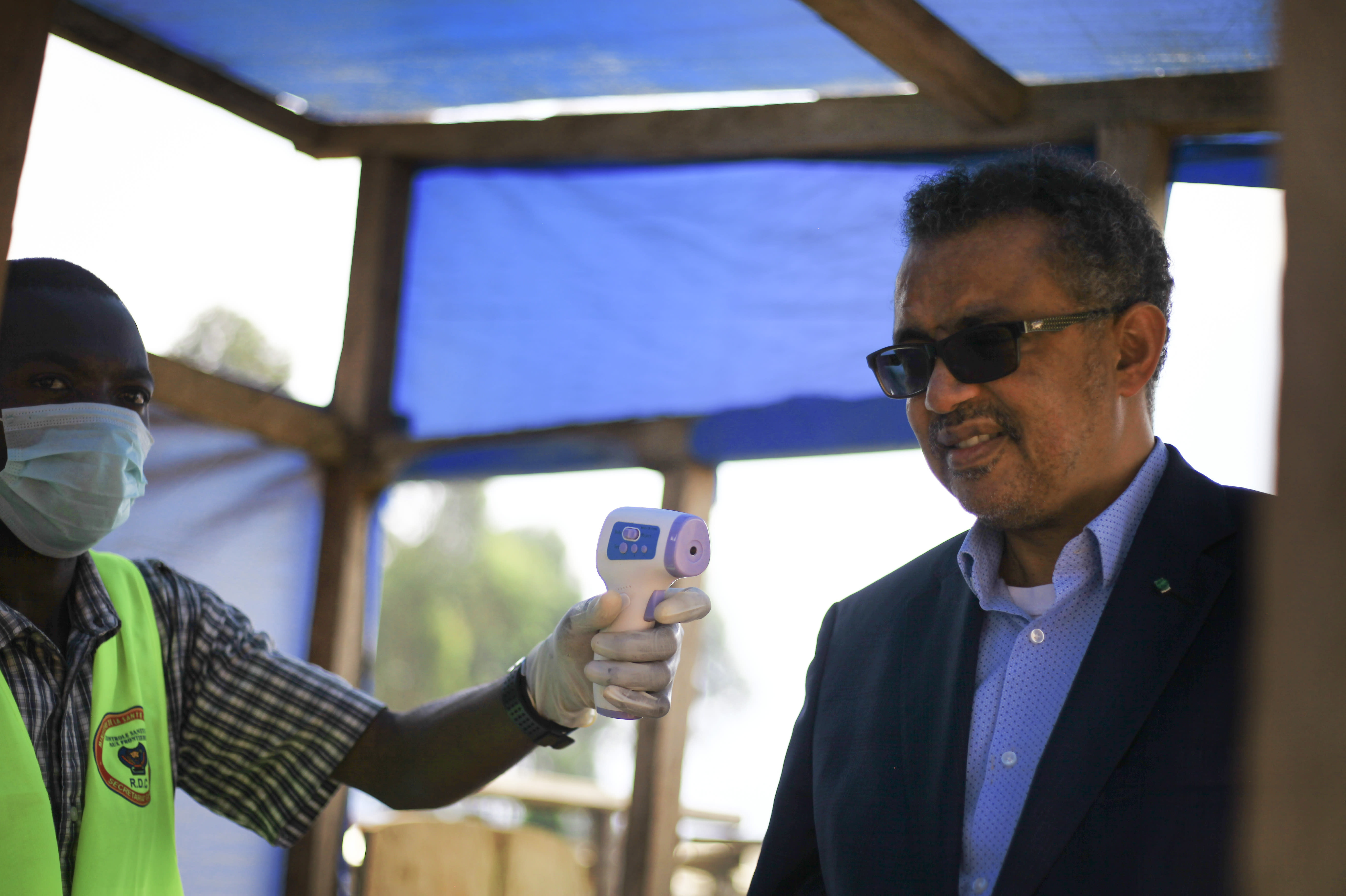 "Director-General of the World Health Organization (WHO), Tedros Adhanom Ghebreyesus, right, has his temperature taken as he arrives at Ruhenda airport in Butembo, to visit operations aimed at preventing the spread of Ebola and treating its victims, in eastern Congo Saturday, June 15, 2019. The World Health Organization on Friday said the Ebola outbreak is an ""extraordinary event"" of deep concern but does not yet merit being declared a global emergency, a declaration that typically triggers more funding, resources and political attention. (AP Photo/Al-hadji Kudra Maliro)"