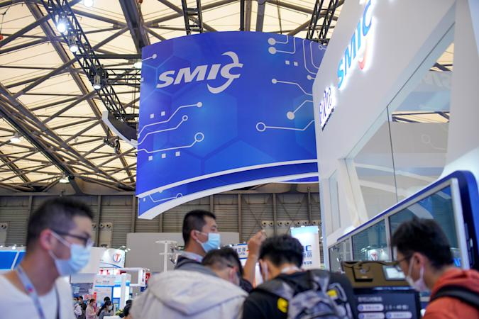 People visit a booth of Semiconductor Manufacturing International Corporation (SMIC), at China International Semiconductor Expo (IC China 2020) following the coronavirus disease (COVID-19) outbreak in Shanghai, China October 14, 2020. REUTERS/Aly Song