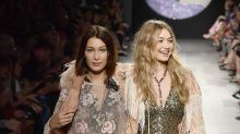 Bella just saved Gigi from a wardrobe malfunction at NYFW