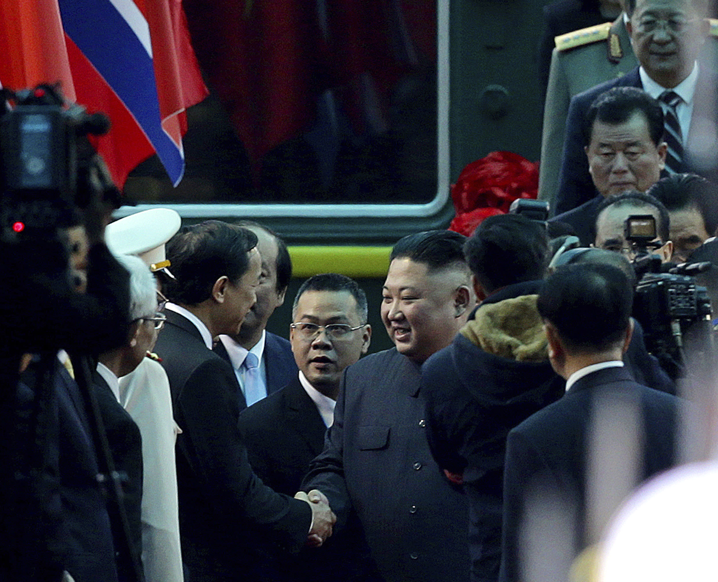 North Korean leader Kim Jong Un, center right, is welcomed upon arrival by train in Dong Dang in Vietnamese border town Tuesday, Feb. 26, 2019, ahead of his second summit with U.S. President Donald Trump. (AP Photo/Minh Hoang)