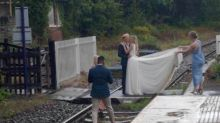 'Plain stupidity': Bride and groom pose for wedding photos on railway track