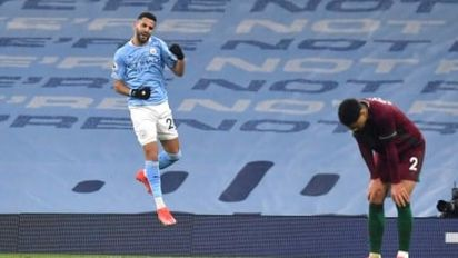 Man City survive scare to extend winning run