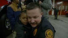 'My heart's filled': Firefighter reunites with child he rescued from a burning building