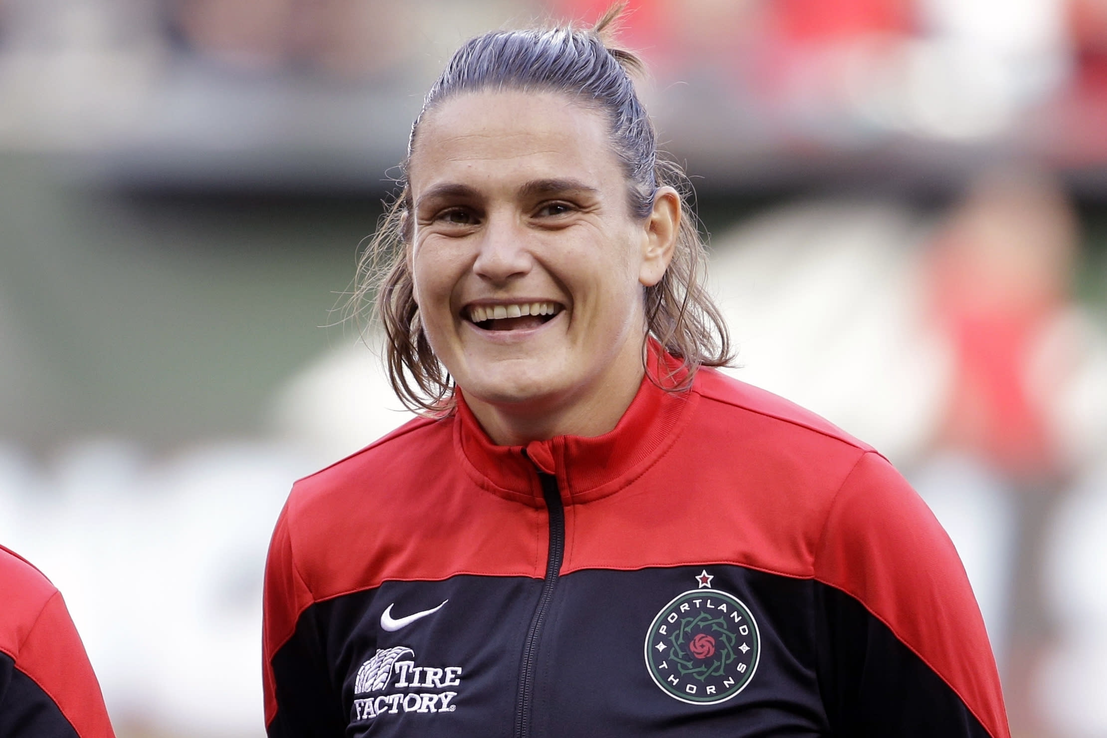 FILE - This is an Aug. 30, 2015, file photo showing Portland Thorns' Nadine Angerer before an NWSL soccer match against the Washington Spirit in Portland, Ore. Former German national team goalkeeper Nadine Angerer has suddenly and unexpectedly found herself on the bench for the Portland Thorns, poised to play as the team navigates injuries at the Challenge Cup tournament. The 42-year-old goalkeeping coach for the Thorns retired from playing five years ago. (AP Photo/Don Ryan, File)