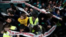 Climate change protesters descend on France's SocGen, energy companies