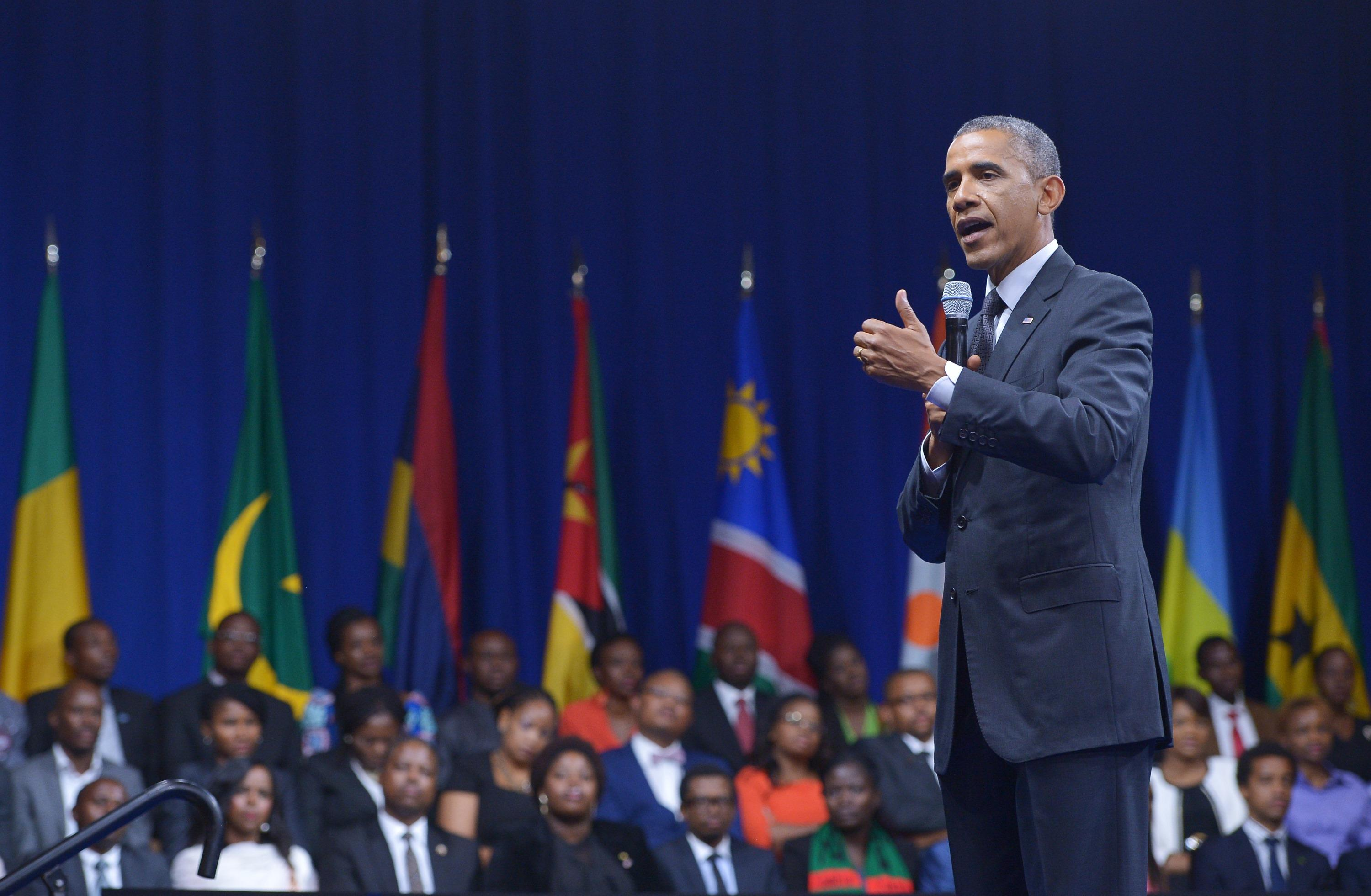 """US President Barack Obama speaks during a """"town hall"""" meeting at the Summit of the Washington Fellowship for the Young African Leaders Initiative in Washington, DC on July 28, 2014 (AFP Photo/Mandel Ngan)"""