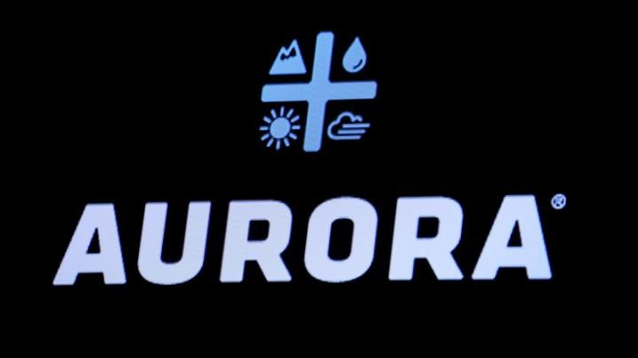 Aurora CEO steps down, announces huge writedown