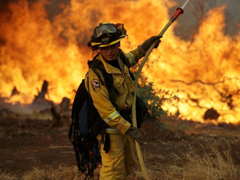 California wildfires: Six dead and tens of thousands forced to flee homes