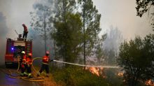 Wildfires trap 2,000 villagers in Portugal