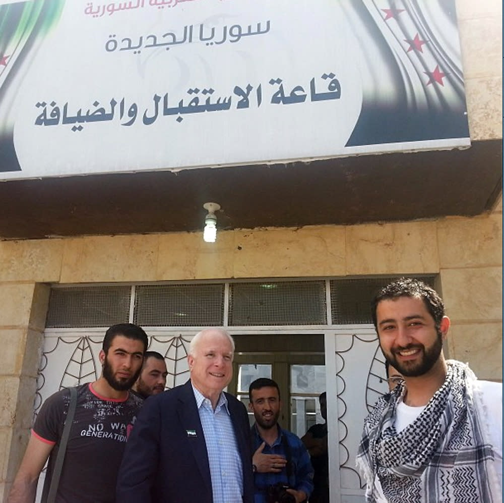 In this Monday, May 27, 2013 photo provided by Mouaz Moustafa and the Syrian Emergency Task Force, Sen. John McCain, R-Ariz., center, accompanied by Moustafa, right, visits rebels in Syria. McCain, who slipped into the country for a surprise visit, favors providing arms to rebel forces in Syria. (AP Photo/Syrian Emergency Task Force, Mouaz Moustafa) MANDATORY CREDIT