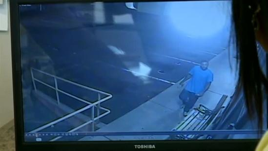 Surveillance video shows man breaking into business