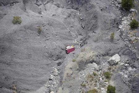 An aerial photo taken from a helicopter shows the crash site of the Germanwings Airbus A320 and its debris on the mountainside near Seyne-les-Alpes, April 3, 2015. REUTERS/Lionel Bonaventure/Pool