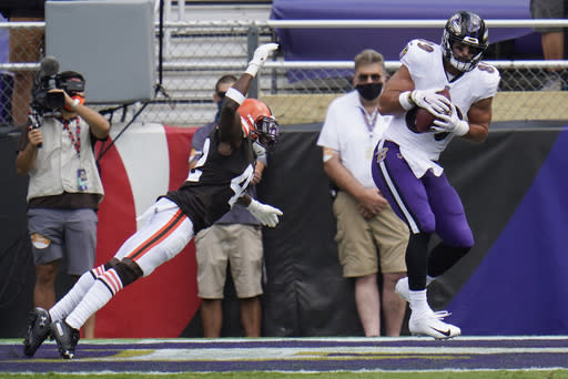 Baltimore Ravens tight end Mark Andrews (89) catches a touchdown as Cleveland Browns free safety Karl Joseph (42) attempts to tackle, during the first half of an NFL football game, Sunday, Sept. 13, 2020, in Baltimore, MD. (AP Photo/Julio Cortez)