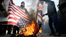 Protesters burn UK and US flags in massive Tehran protest over killing of Iranian military commander
