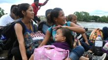 Mexico opens border to women and children from migrant caravan