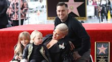 Carey Hart baits parenting critics by letting daughter Willow pop balloons with a knife: 'Don't worry, she survived'