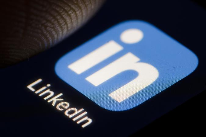 BERLIN, GERMANY - DECEMBER 14: The Logo of business and employment-oriented service LinkedIn is displayed on a smartphone on December 14, 2018 in Berlin, Germany. (Photo by Thomas Trutschel/Photothek via Getty Images)