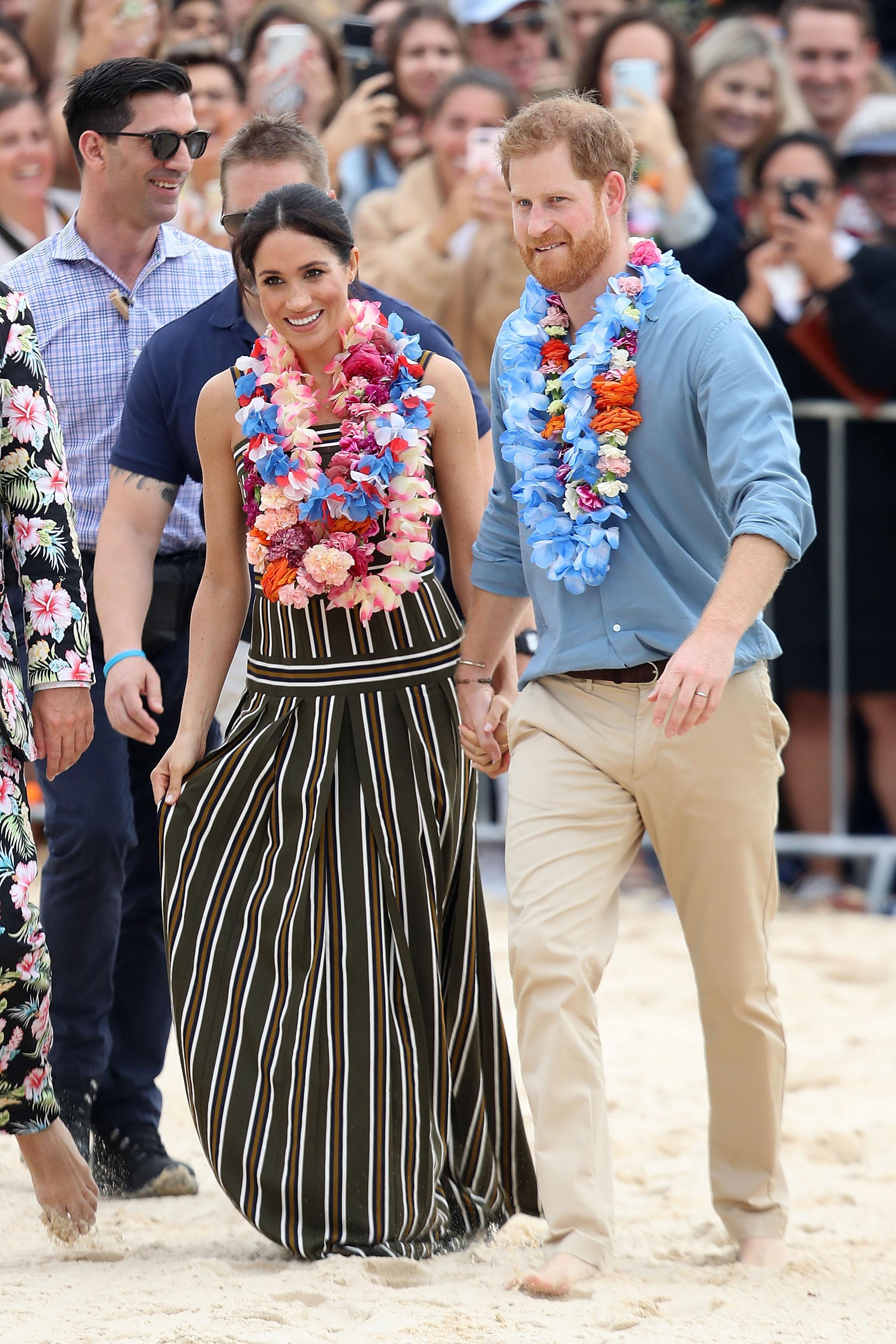 7d083acf15 Meghan Markle and Prince Harry visited Sydney s Bondi Beach on Friday and  took off their shoes