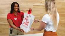As Amazon races to deliver in a day, Target drives digital customers to stores