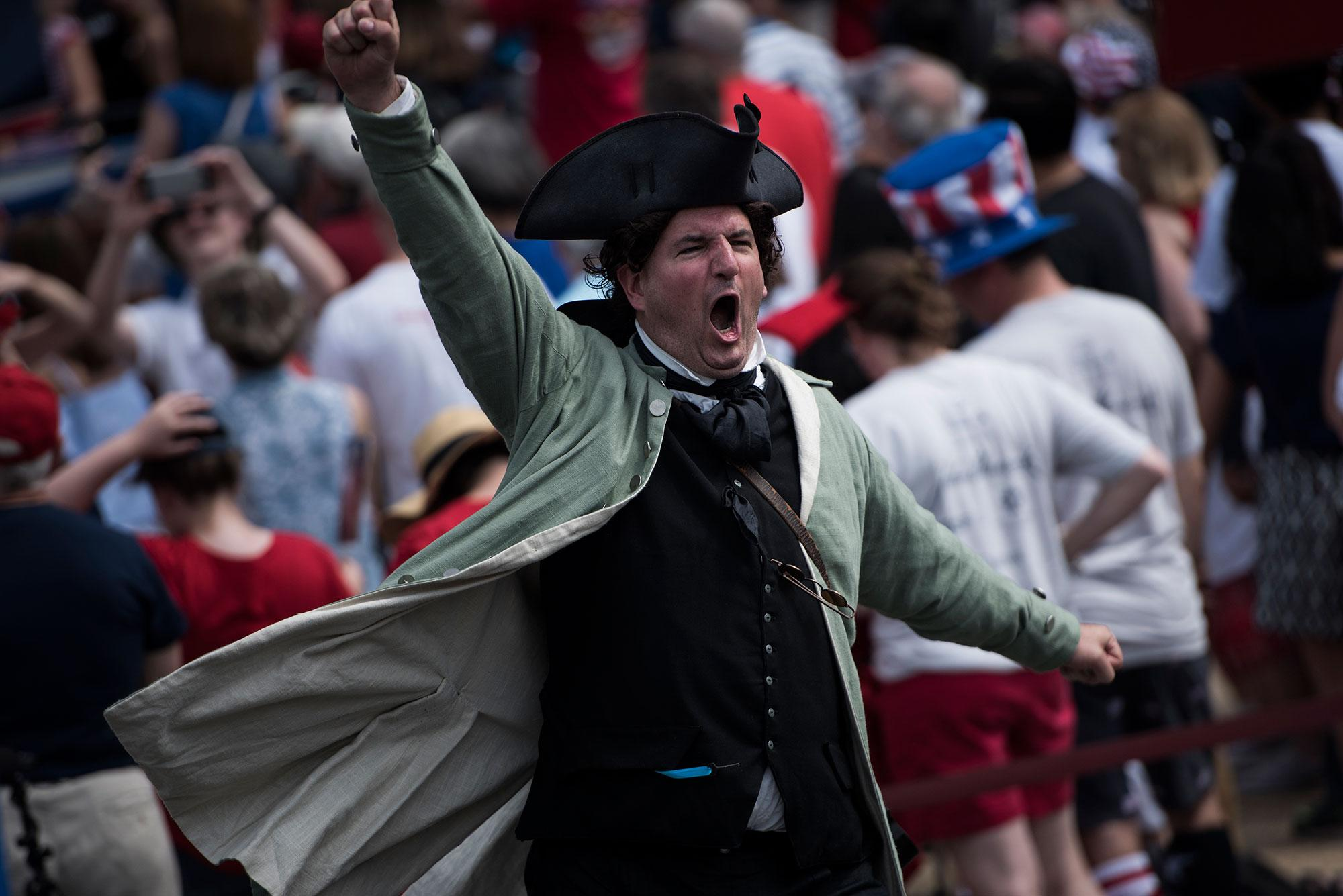 <p>A costumed man cheers during a show outside the National Archives to celebrate Independence Day on July 4, 2017 in Washington, D.C. (Photo: Brendan Smialowski/AFP/Getty Images) </p>