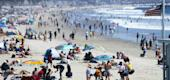 People gather on a beach in Santa Monica, Calif., amid the COVID-19 pandemic. (Mario Tama/Getty Images)